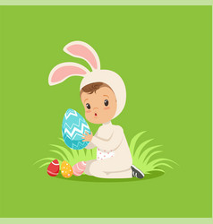 Sweet little baby in bunny costume sitting on the vector