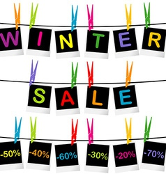 Winter sale concept with photo frames hanging on vector image