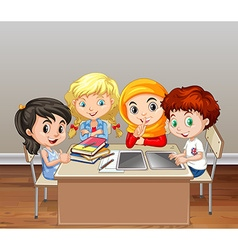 Children working in group in classroom vector