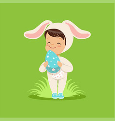 Sweet little baby in a white bunny costume holding vector
