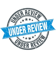 under review blue round grunge vintage ribbon vector image