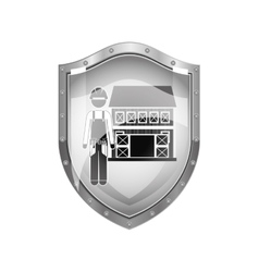 Metallic shield of builder with helmet and house vector