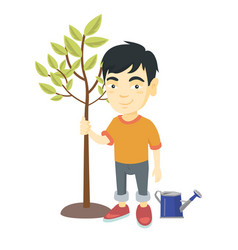 Asian smiling boy planting a tre vector