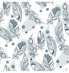 seamless tribal pattern with feathers in graphic vector image