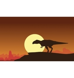 Silhouette of mapusaurus at the sunset vector