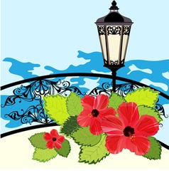 Tropical coastline with lantern fence and flowers vector image