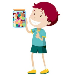Boy carrying jar of candy vector image