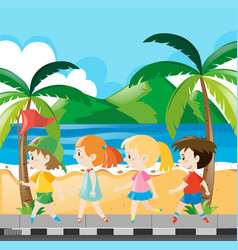 Boys and girls walking along the beach vector