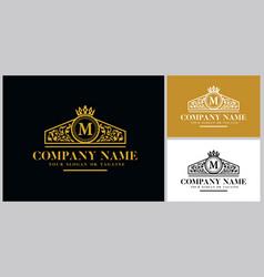 Letter m logo design luxury gold vector