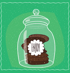 Glass jar with stack of chocolate cookies inside vector