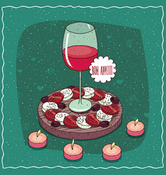 Glass of red wine and salad caprese vector