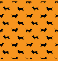 Seamless pattern with black dogs silhouettes vector