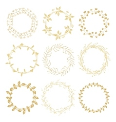 Hand drawn gold floral wreaths vector image