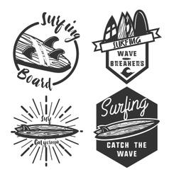 Vintage surfing emblems vector image