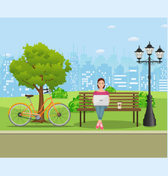 young woman works in park with computer vector image