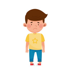 Dark-haired boy standing with sadness on his face vector