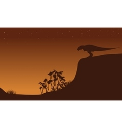 Silhouette of Tyrannosaurus on cliff vector image vector image