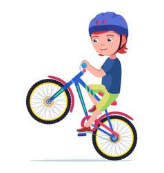Boy riding a bike vector