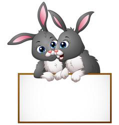 Cartoon rabbit couples holding empty board vector