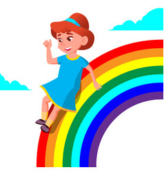 Happy child girl rolling down the rainbow vector
