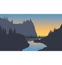 Silhouette of river and bridge vector image