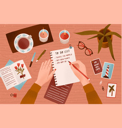 woman s hands holding pen and writing down goals vector image