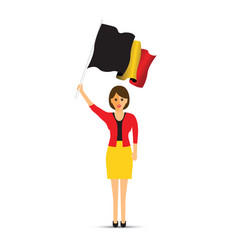 woman waving a belgium flag vector image