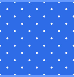 Seamless pattern with white polka dots on a blue vector