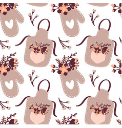 Seamless pattern with apron oven mitt potholder vector