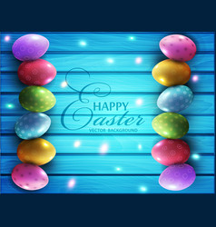 colored eggs lying on a blue wooden board vector image