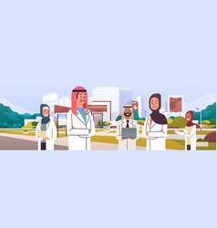Group arabic doctors team in uniform standing vector