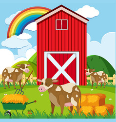 Three cows and red barn in the farmyard vector