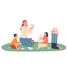 Kindergarten teacher plays with children she vector
