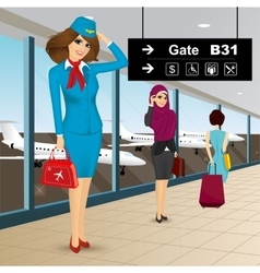beautiful air hostess in an airport vector image