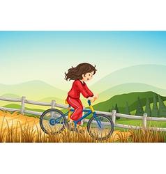 A girl biking at the farm vector