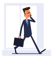Businessman walking and talking on the phone vector