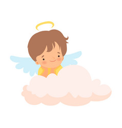 Cute boy angel with nimbus and wings sitting on vector