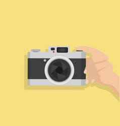 Hands holding with a camera vector
