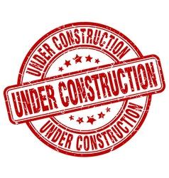 Under construction red grunge round vintage rubber vector