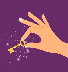 Golden sparkling key in hand vector