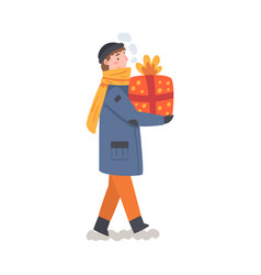boy in winter clothing holding gift box boy vector image
