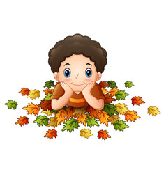 Cute little boy with autumn leaves vector
