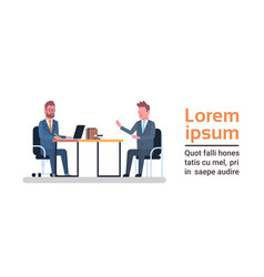 two business men sitting at office desk talking vector image vector image