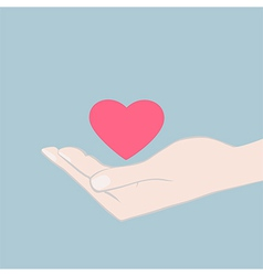 Hand cupping a red heart vector image vector image