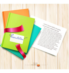 books and magazines lying on wooden table vector image
