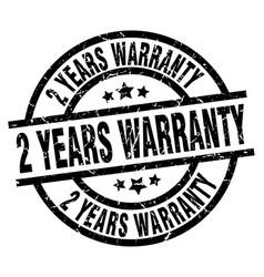 2 years warranty round grunge black stamp vector image vector image