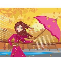 Girl with umbrella on a rainy autumn day vector