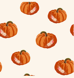 Seamless autumn pattern with pumpkins and flowers vector