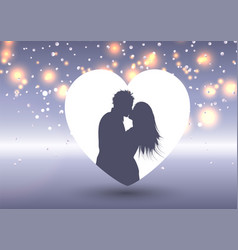 silhouette a kissing couple in a heart vector image