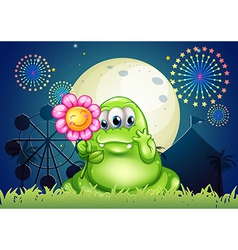 A fat green monster holding a flower at the vector